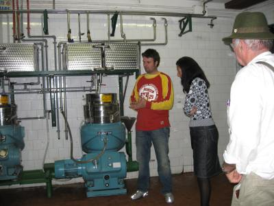Olive oil maker and farmer shows us and our lovely tour guide, Mary Cannavo, how he makes oil.  -- Photo by Jo McIntyre